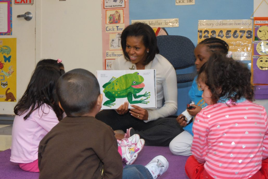 Michelle Obama reading to young children in Briya classroom