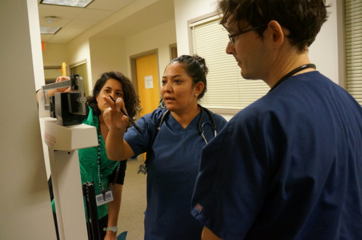 Medical Assistant students learning to use a scale