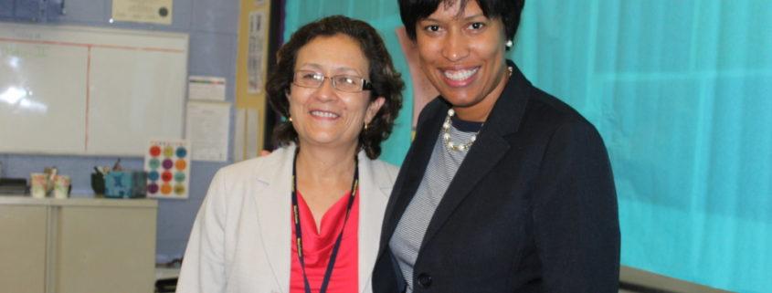 Mayor Bowser with Briya student council member