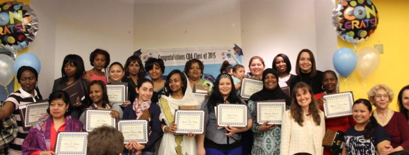 Graduates holding up their diplomas