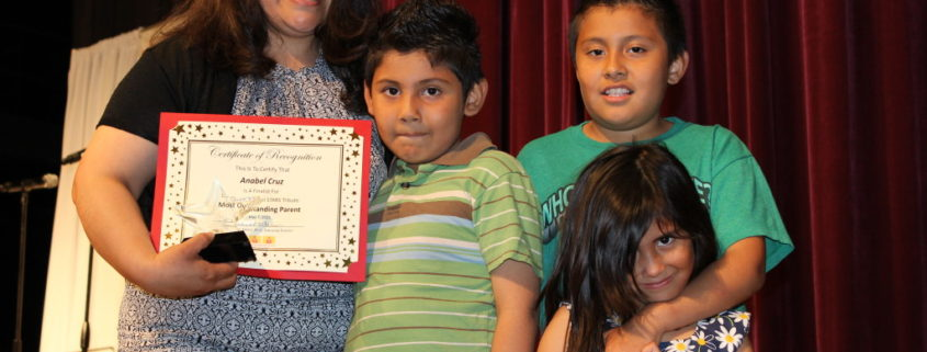 Anabel Cruz and her children after receiving her award