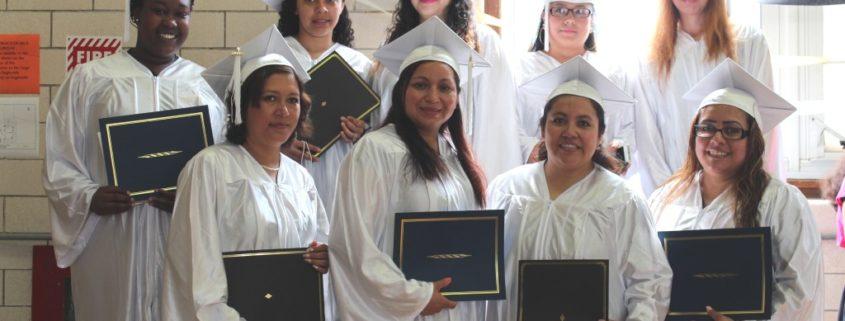 MA graduates pose with their diplomas