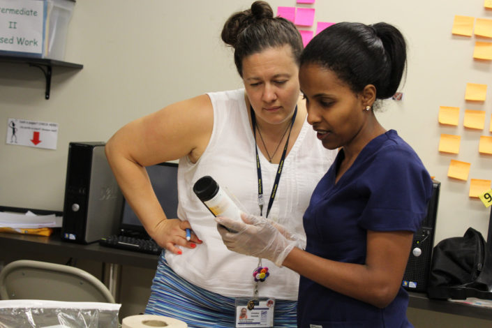 Medical Assistant student training with instructor