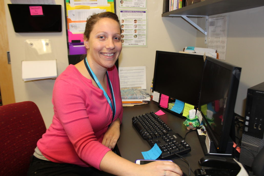 Briya staff member Jodi Birkey sitting at her desk